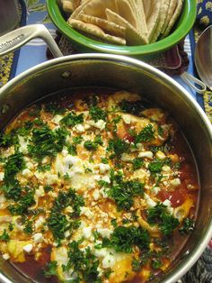 Shakshuka and pita- easy, quick and cheap!  recipe: http://smittenkitchen.com/2010/04/shakshuka/