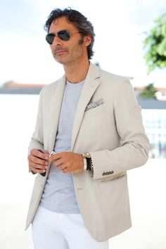 """An ode to summer from the depths of early winter. A fitted jacket can be worn with a t-shirt and look classic. I couldn't agree more with The Sartorialist regarding the pocket square: """"On paper I would say it never works, but when you see it done like this it's quite reasonable."""""""