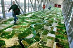 "mapmaking - This aerial view of the Sacramento River is an installation piece entitled ""Flying Carpet"" created by Iranian artist Seyed Alavi for the pedestrian bridge connecting a terminal to a parking garage at the Sacramento International Airport. Carpet Design, Floor Design, Instalation Art, Floor Graphics, Pedestrian Bridge, Environmental Graphics, Modern Carpet, Modern Rugs, Modern Flooring"