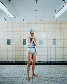 Rineke Dijkstra's self portrait. The first to spark her technique to photograph subjects whom are completely exhausted (New Mothers and Bullfighters), therefore less likely to strike a pose. This was taken after Rineke had swum 30 laps in her pool during rehabilitation after an accident resulting in a broken hip.