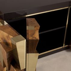 A Burr and Brass Faceted Paul Evans Cabinet for Directional 1970 | From a unique collection of antique and modern credenzas at http://www.1stdibs.com/furniture/storage-case-pieces/credenzas/