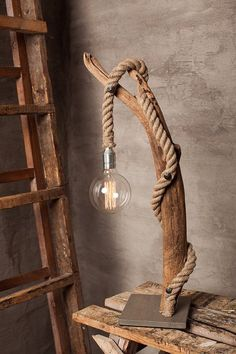 Incredibly cool way of adapting our Liana Hanging Light to a tree limb lamp base. Rustic, unique and stylish piece Forest Homes Large Driftwood lamp with round Edison bulb. Home by Glighthouse This large and stylish indoor lamp offers modern as well as or Bedside Lighting, Bedroom Lighting, Home Goods Decor, Diy Home Decor, Lighthouse Lamp, Lampe Edison, Driftwood Lamp, Diy Vintage, Lampe Decoration