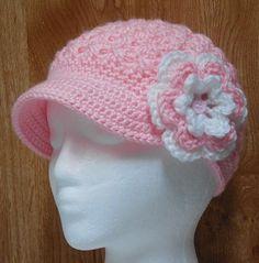 http://www.etsy.com/nl/listing/122949334/pdf-crochet-pattern-newsboy-twist-up-hat
