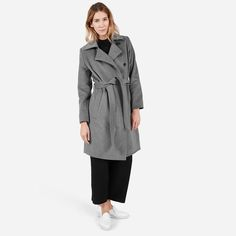 """A wool-cashmere trench made from Italian-milled fabric and belted for a sophisticated touch 65% wool, 15% cashmere, 15% polyamide, 5% other fibers 100% polyester lining for body and sleeves Features front slant pockets, a large collar, and two 5"""" neck darts Dry clean only"""