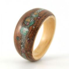 Breaking Traditions Mahogany and Crushed stone Engagement Ring. Each ring is handcrafted in Chicago, IL. Created with salvaged materials.