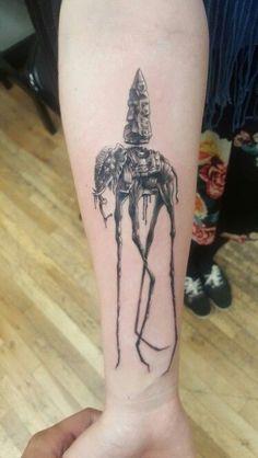 Dali elephant tattoo