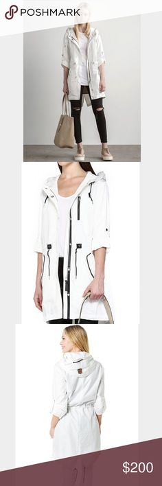 Mackage Norma Raincoat XS NWT Springs almost here! Gorgeous raincoat BNWT don't need it bc boyfriend just bought me another beautiful one. Cinched drawstring waist, white/black combo (not white-white like 1st stock photo, posted for the style-fit), Teflon shield fabric repels water/oil/stains, can be worn long sleeve or rolled up 3/4 sleeve with buttons. Size XS can fit up to a S bc of drawstring. $350+ Always negotiable :) Mackage Jackets & Coats Utility Jackets
