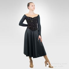 Dance leotard made with mid-calf circle skirt, nude front and back insets with liner, long black sleeves with finger loops. 90%Polyester, 10%Spandex. Sizes: Child's: MC, LC      Adult's: XS, SA, MA, LA