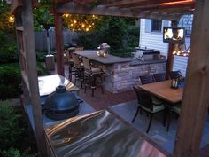 Coolest outdoor kitchen, and yes, that's a tv.