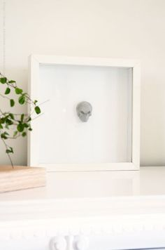 Diy concrete skull and frame it.