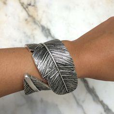Feather Cuff Bracelet A bold, feather cuff bracelet. NWT. Jewelry Bracelets