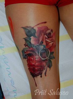Surrealist anatomical heart grenade and rose tattoo on the right thigh.