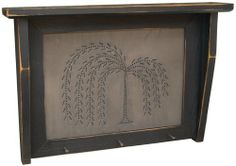 """Shelf Primitive Country Rustic Willow Tree by CWI. $39.99. Tin Panel. Distressed Finish. Willow Tree Shelf is a black wood shelf with a distressed finish. On the front panel of the shelf there is a tin insert with a punched design of a willow tree. Shelf includes 3 metal nails across the bottom as hangers. Size of the Willow Tree Shelf is 14""""H x 20""""W."""