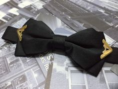 Black bow tie with gold colour metal tips, mens bow tie, wedding, party, steampunk, pointed bowtie, groom, groomsmen, pre-tied. $20.00, via Etsy.
