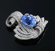 ❤ -  Art Deco Sapphire & Diamond Brooch - 12.13 ct blue sapphire & platinum brooch surrounded by approx 2.75 cts of white diamonds.
