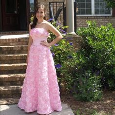 Pink Rosette Prom Dress This beautiful dress is so unique and is a showstopper! The dress has ribbon rosettes all over and features a natural waist. Perfect for prom or any other special occasion! Handmade Dresses