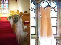 church pews decorated with dried hydrangeas, bridesmaid's peach dress - winston salem wedding photography - raleigh nc wedding photographers