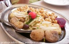 Cod With Chickpeas from Joao do Grao  http://www.chowzter.com/fast-feasts/europe/Lisbon/review/Joao-do-Grao/Cod-With-Chickpeas/4571_4587