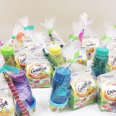 Birthday party day! Put together these rainbow-themed goody bags for Asa's little friends.