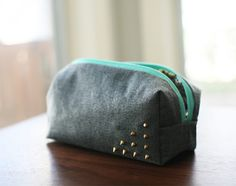 DIY: Essential Make Up Bags | Studding is the new black. We found this edgy make up bag for all you rebels out there. It definitely speaks to the little rebel inside of us!