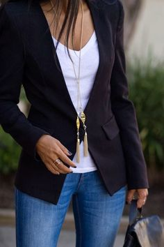 Black blazer, white shirt and jeans with long necklace