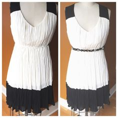 Zara Black and Ivory Sleeveless dress! Great condition size small. 26 inch waist with elastic waist band. Zipper on back. Loose fit on top and bottom. Zara Dresses