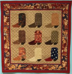 """Wall Quilt 8, """"Roy, Gene, Gabby, and The Gang"""" by Connie Beane  """"This is one of in a series of quilts called I Remember Prime Time, which are based on televisions show I remember watching when I was a child. Roy, Gene, Gabby and the Gang was inspired by the very short cowboy movies that were often shown on Saturday afternoons, and depict the kinds of boots that might have been worn by my favorite stars: Roy Rogers, Dale Evans, Gene Autry, Gabby Hayes, and others."""" Dale Evans, Roy Rogers, Televisions, Prime Time, Capital City, Quilts, Inspired, My Favorite Things, Stars"""