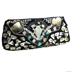 Native stones and alluring seashells embellish this exotic handcrafted clutch-bag from the Philippine Archipelago. With this ornate clutch under your arm, you can easily go from day to evening with elegance and style.  -Handmade Mosaic Beauty Natural Shells Clutch-
