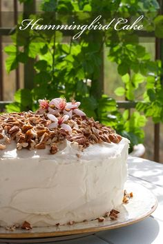 Classic Southern hummingbird cake with bananas, pineapple, chopped pecans, and topped with a cream cheese frosting! On SimplyRecipes.com