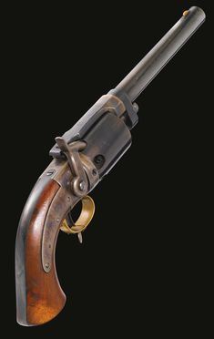 Massachusetts Arms Co., Wesson & Leavitt Patent .40 Caliber Dragoon Revolver, Serial No. 224, circa 1852.  Blued round barrel with fore-sight, top-strap marked MASS. ARMS CO. / CHICOPEE FALLS, 6-shot .40 caliber cylinder, lock-plate marked WESSON'S & LEAVITT'S PATENT, case-hardened breech, lock-plate, top-strap and hammer, blued cylinder, cylinder arbor latch (marked PATENT NOV. 26. 1850) and back-strap, brass trigger-guard, brass collection tag marked 245, oil-finished walnut grips.