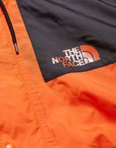 9a79855a87 The North Face 1985 Mountain Jacket Seasonal Celebration Orange - New In at  The Idle Man