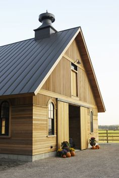 I like the vertical siding on top, horizontal siding on lower half.