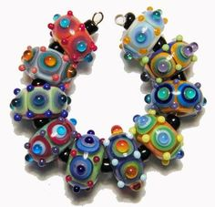 these are fantastic...each bead has so many layers of color. These have to take at least 20 minutes each to create, probably longer.