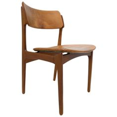 Teak and Leather Chair by Erik Buck | From a unique collection of antique and modern dining room chairs at https://www.1stdibs.com/furniture/seating/dining-room-chairs/