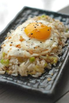 Ginger Fried Rice (Serves 4)    - 1/2 cup peanut oil  - 2 tablespoons minced garlic  - 2 tablespoons minced ginger  - Salt  - 2 cups thinly sliced leeks, white and light green parts only, rinsed and dried  - 4 cups day-old cooked rice, preferably jasmine, at room temperature  - 4 large eggs  - 2 teaspoons sesame oil  - 4 teaspoons soy sauce    (http://www.minnesotamonthly.com/media/Blogs/Dear-Dara/January-2012/FreshTartSteph-Recipe-Ginger-Fried-Rice/)