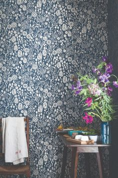 This delicate Farrow & Ball botanical wallpaper design combines rich texture and pattern, to create a fun and playful tropical design. Shown here in the blue colourway, with metallic silver detailing