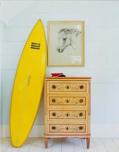 A display-worthy yellow surfboard