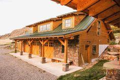 Rustic Garage with exterior stone floors, Wrap around porch, Pathway