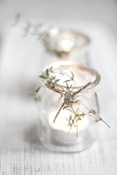 Jam jars wrapped with twine and thyme