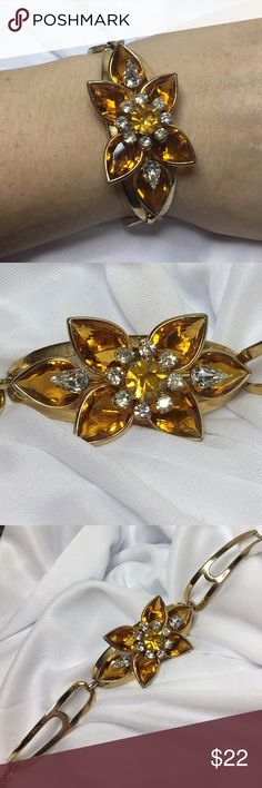 """🆕Vintage Coro Yellow Citrine Rhinestone Bracelet A 6.5"""" around gold bracelet with Yellow Citrine and Clear rhinestones in a perfect flower. Nicely articulated for ease of wear. From the 1940s and considered rare to find! In excellent vintage condition, marked at clasp as shown. Absolutely gorgeous; almost didn't want to part with this one! Vintage Jewelry Bracelets"""