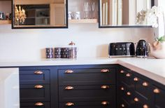 navy cabinets paired with copper hardware