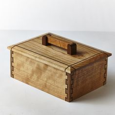 Cherry and walnut keepsake box with double dovetail joints and sliding dovetail handle.