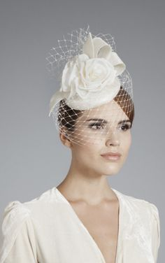 Gina Foster Millinery, Bridal 2014 - Ivory straw button base with birdcage veiling and a straw ribbon and silk rose trim.  Secured with an elastic that sits under the hair.