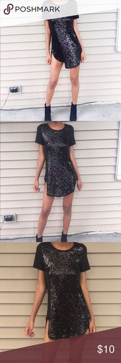 Black Sparkly T-Shirt Dress Black, Sparkly and Stylish. The T-shirt dress is fitted at the top and flows towards the bottom. Rue 21 Dresses Mini