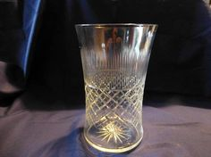 Check out this item in my Etsy shop https://www.etsy.com/uk/listing/510231400/vintage-edwardian-fine-glass-vase-etched
