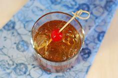 Elderflower Manhattan. Rye, elderflower syrup, sweet vermouth, bitters. Garnish with Luxardo cherry.