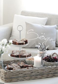 Sweets in a Little tiered stand and more in a wicker tray...fireplace and a wonderful view of the Laguna!! Habacuc 2:2.
