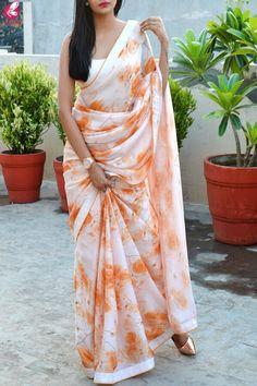 Buy White Orange Digital Print Satin Georgette Dupion Silk Taping Saree Online in India Simple Sarees, Trendy Sarees, Stylish Sarees, Fancy Sarees, Satin Saree, Chiffon Saree, Lace Saree, Saree Jacket Designs, Shibori Sarees
