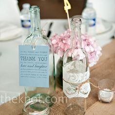 Recycled jars and clear wine bottles accented with tea lights and hydrangeas.