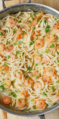 Garlic Shrimp Alfredo Pasta – a simple, 35-minute dinner! Shrimp is cooked in butter and lots of garlic, then tossed in a homemade, very creamy white cheese Italian pasta sauce (with the four-cheese blend)